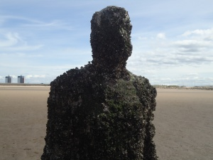 One of Anthony Gormley's Iron Men covered with barnacles