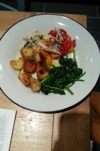 Roasted seabass with rosemary potatoes, peppers and spinach